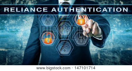 Security manager is activating the phrase RELIANCE AUTHENTICATION on a touch screen. Information technology concept for a multi-factor authentication process or trust-based identity allocation.