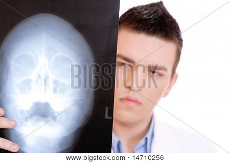 Caucasian mid adult male doctor holding up xrays. over white background