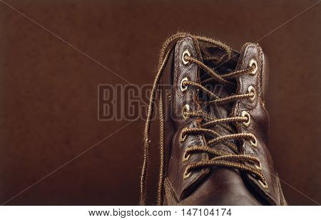 The old leather shoes and brown lace