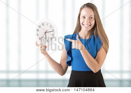 Woman Pointing At Clock