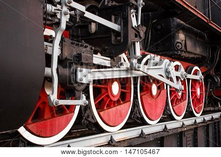 Painted with new paint mechanism of the front wheels of old steam locomotive close up