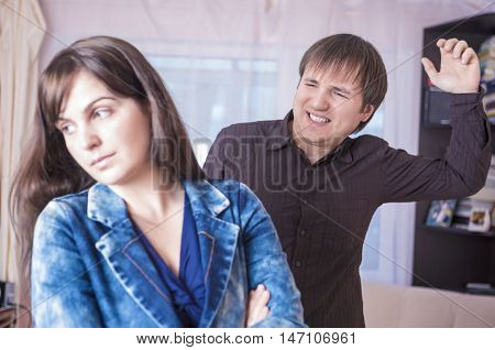 Family Violence Concepts. Man and Woman Arguing Emotionally Together. Indoors Shot. Horizontal Image Composition
