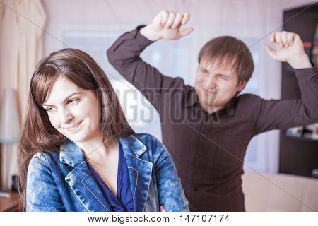 Family Violence Concepts. Young Caucasian Couple Quarrel Indoors.Horizontal Image Orientation