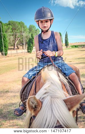 Little boy on the horse. Horseback riding