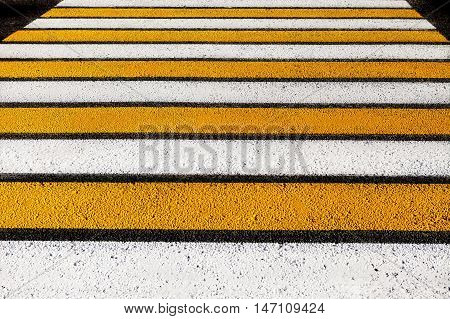 pedestrian crossing. stripes of white and yellow