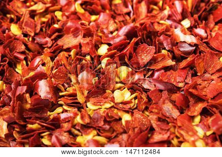 Crushed red pepper, close-up, with depth. Shallow depth of field.