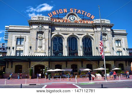 September 12, 2016 in Denver, CO:  People walking to catch their train at Union Station which is a historic building landmark completed in 1914 and is the main transportation hub in Denver where people can catch local light rail lines and including Amtrak