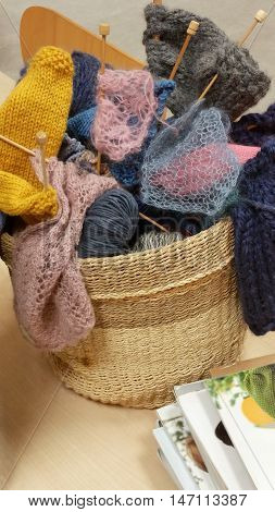 Wool yarn of different colours in rattan basket