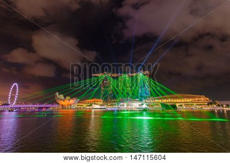 SINGAPORE -JUNE 27: Wonderful laser show at the Marina Bay waterfront in Singapore. Marina Bay Sands Hotel dominates the skyline at Marina Bay on Jun 27 2015.