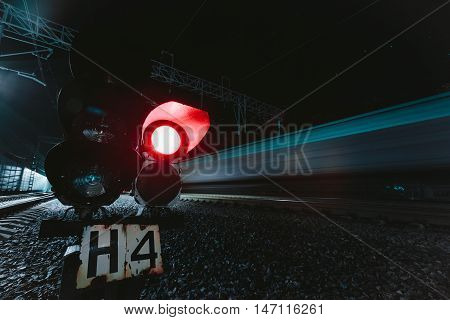 Red semaphore railway night. Photo on long exposure night