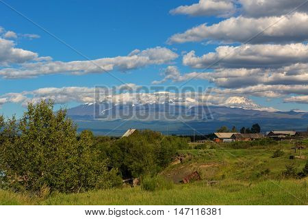Kozirevsk village on the shore of the Kamchatka River in the background Kluchevskaya group of volcanoes