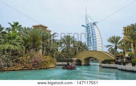 View of Burj Al Arab (Tower of the Arabs) hotel from Madinat Jumeirah hotel Dubai. Madinat is a luxury resort which includes hotels and souk spreding across over 40 hectars.