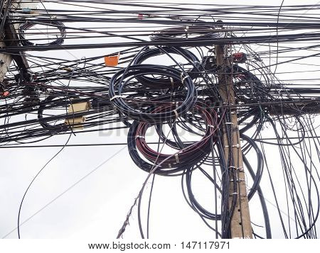Chaos of cables and wires on electric pole in Chiang MaiThailand.