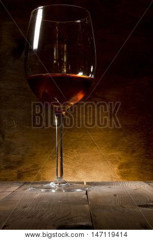 Glass of red wine on a wooden background