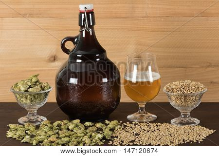 Growler, goblet of beer with hops and malts