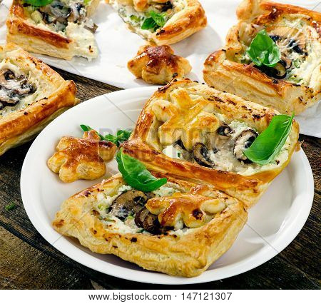 Puff Pastry Mushroom Tarts On A Wooden Table
