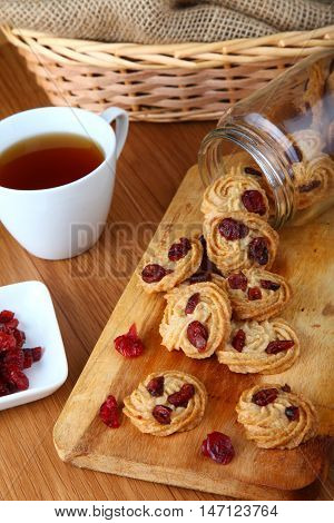 red raisin cookies served with tea out from the jar