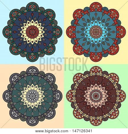 Set of four color versions of boho mandala ornaments. Hand drawn pattern prints for ethnic style decor.