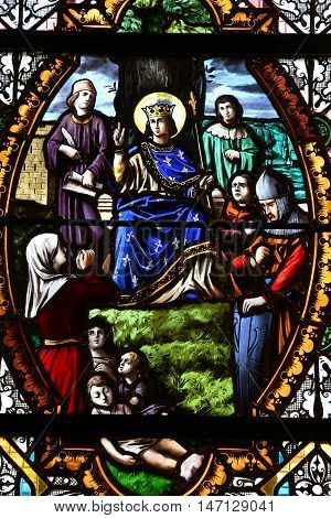 Saint Wandrille Rancon France - june 22 2016 : Saint Louis in a stained glass window of Saint Michel church