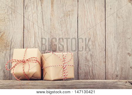 Christmas gift boxes in front of wooden wall. View with copy space for your text. Toned