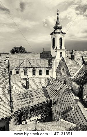 Annunciation church and red roofs of old houses Szentendre Hungary. Religious architecture. Beautiful place. Black and white photo. Place of worship.
