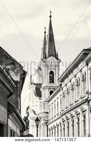 Saint Ignatius church and christian museum in Esztergom Hungary. Religious architecture. Place of worship. Travel destination. Cultural heritage. Black and white photo.