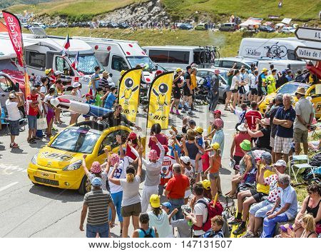 Col du Glandon France - July 23 2015: BIC vehicle during the passing of the Publicity Caravan on Col du Glandon in Alps during the stage 18 of Le Tour de France 2015. BIC is a global company which offers an extensive line of writing and office tools.