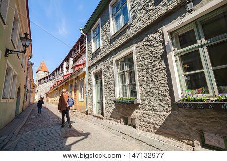 People Walking On Narrow Street In Old Tallinn