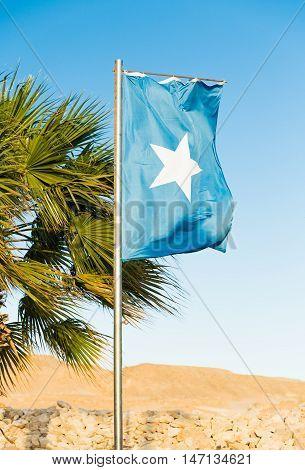 Waving National flag of Somalia on flagpole