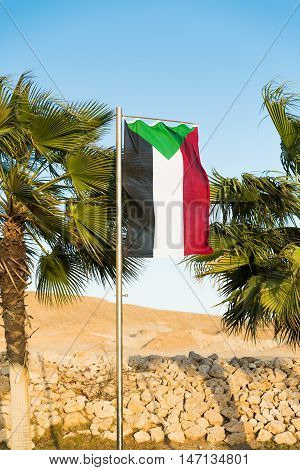Waving National flag of Sudan on flagpole