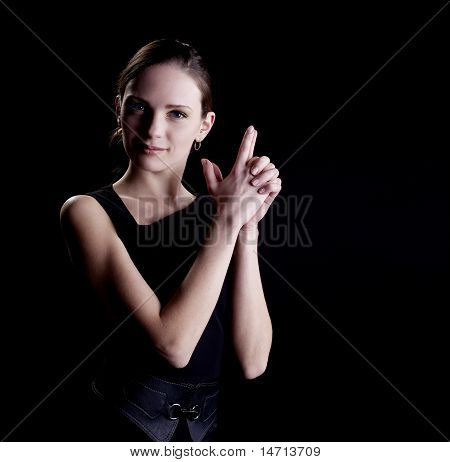 Young woman portrait with gun sign