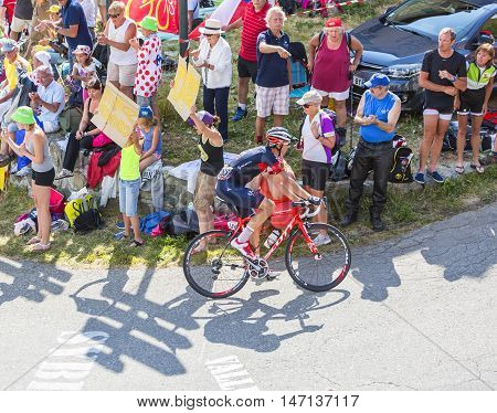 Col du Glandon France - July 23 2015: The Swiss cyclist Martin Elmiger of IAM Team riding on the road to Col du Glandon in Alps during the stage 18 of Le Tour de France 2015.