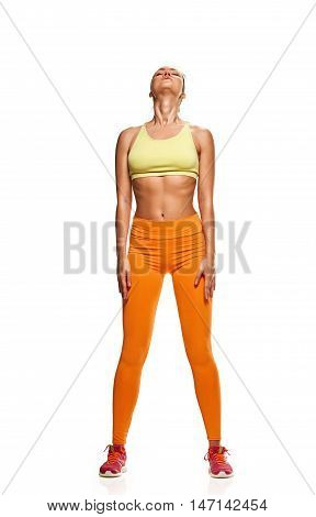 fitness woman. Young sporty Caucasian female model isolated on white background in full body. relaxing pause