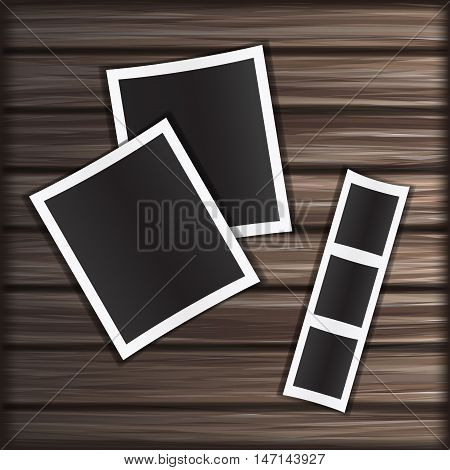Blank photo frame on wooden texture background.
