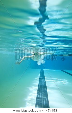 Little Boy Swimming Underwater