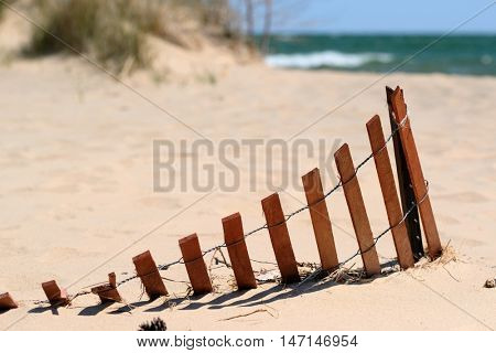 Beach with wooden fence at Lake Huron, Michigan, USA