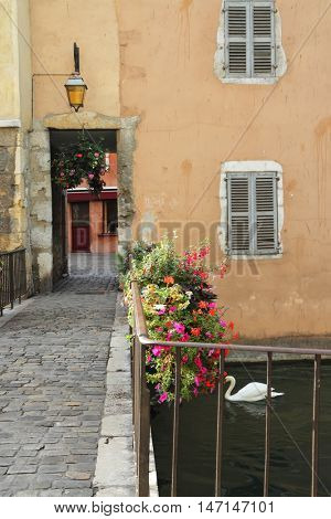 The ancient city in the south of France - Annecy. Canal, bridge and suite of transitions in the houses on the waterfront