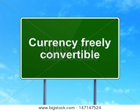 Money concept: Currency freely Convertible on green road highway sign, clear blue sky background, 3D rendering