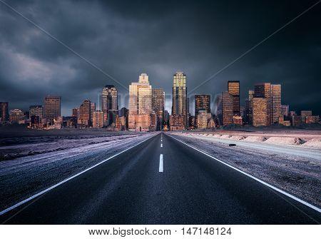 A road heading into a moody city