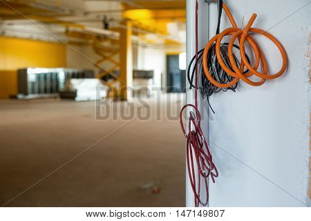 Renovation of a small business offices. Bunch of cables waiting to be conected. Growing business expanding business entering to the market concept photo.