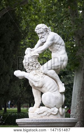 Statue of Hercules fighting against a lion in Retiro Park, Madrid, Spain