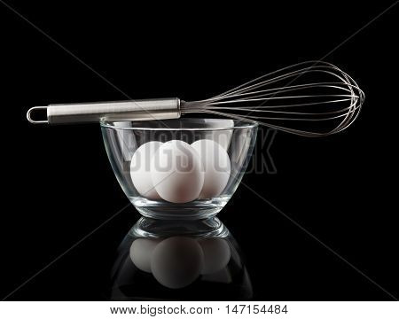 Wire Whisk On Bowl With Tree Eggs