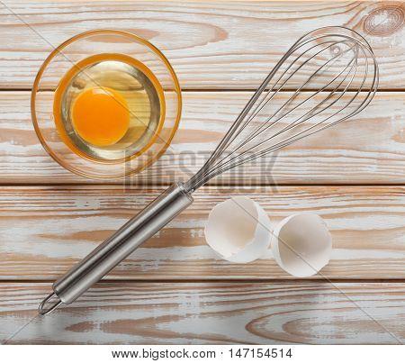 Whisk And Egg Ready For Whisking