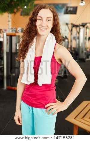 Content proud woman after training at the gym