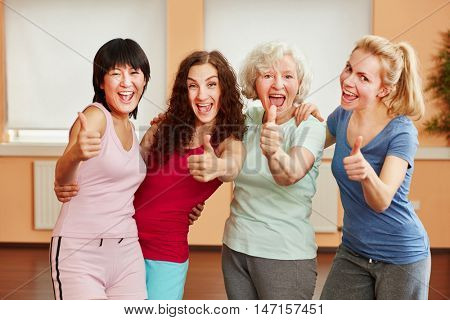 Successful woman with thumbs up at fitness studio
