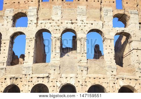 Ruins of cyclopean building with of genius architecture. Facade of Coliseum