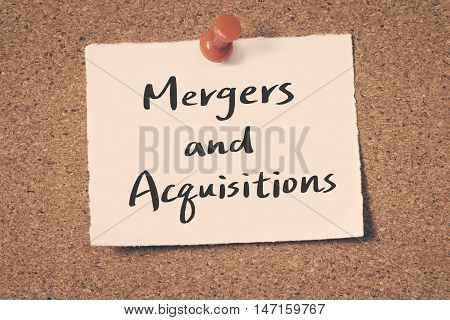 Mergers and Acquisitions note pin on the bulletin board