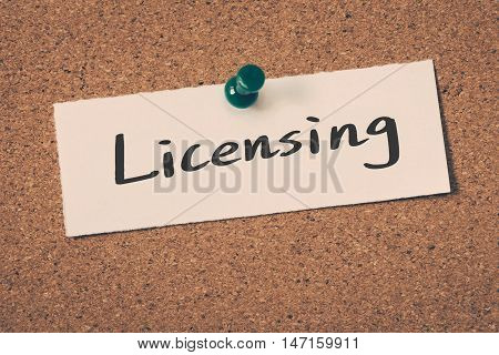Licensing note pin on the bulletin board
