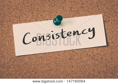 Consistency note pin on the bulletin board