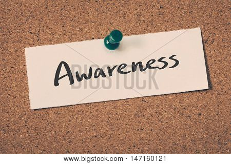 Awareness note pin on the bulletin board